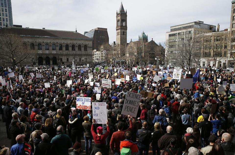 Scientists, science advocates, and community members rallied in Copley Square in Boston today.